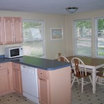 This modern cottage offers an updated kitchen which includes a dish washer.